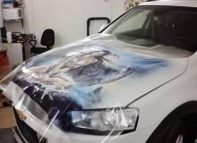 Ангелы и демоны на капот Chevrolet Captiva